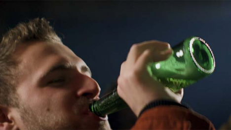 Young-Man-Drinks-Beer-from-Bottle