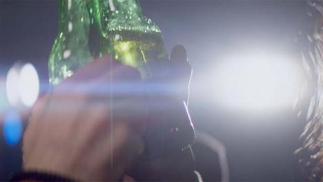 Smiling-Woman-Clinks-Beer-Bottle