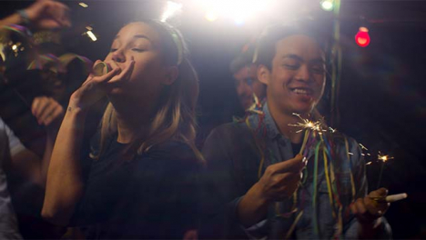 Friends-have-Fun-with-Sparklers-and-Streamers