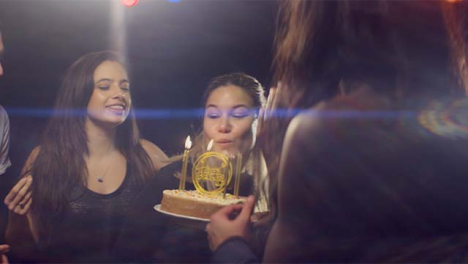 Young-Woman-Blows-Out-Birthday-Candles