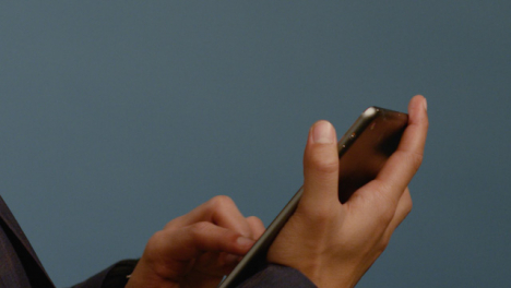 Man-Browses-on-His-Tablet-Close-Up