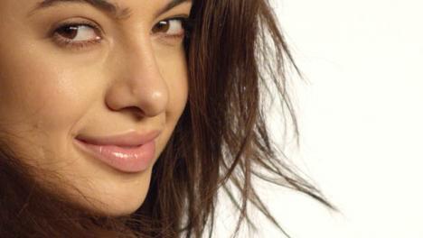 ECU-Smiling-Woman-Turns-to-Camera