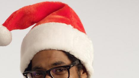 CU-Man-Puts-on-Santa-Hat-