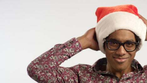 CU-Smiling-Young-Man-Puts-on-Santa-Hat