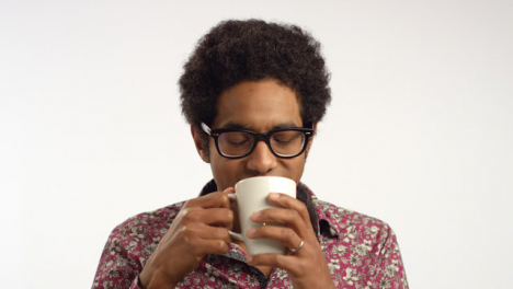 CU-Young-Man-Drinks-From-a-Mug