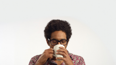 CU-Young-Man-Drinks-Coffee-From-a-Mug
