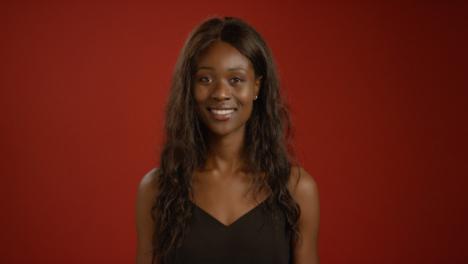 Young-Woman-Smiles-at-Camera