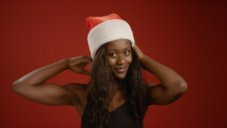 Young-Woman-Puts-a-Santa-Hat-on