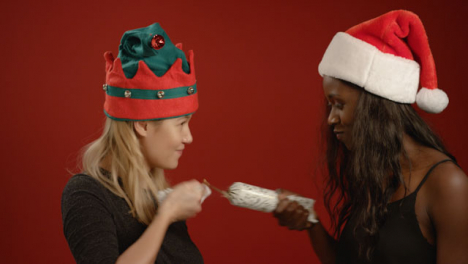 Two-Women-Pull-A-Christmas-Cracker