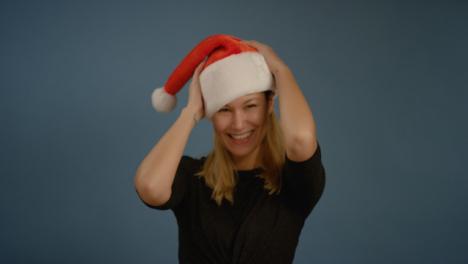 Woman-Flicks-Head-with-Santa-Hat