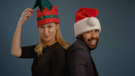 A-Couple-Have-Fun-with-Festive-Hats-on