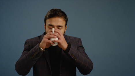 Young-Man-Drinks-From-a-Mug
