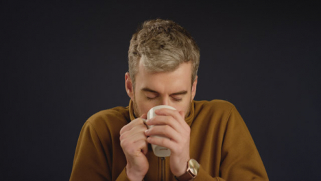 Man-Takes-a-Drink-From-Mug