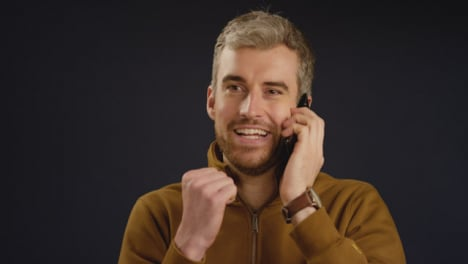 Man-Receives-Good-News-on-Phone