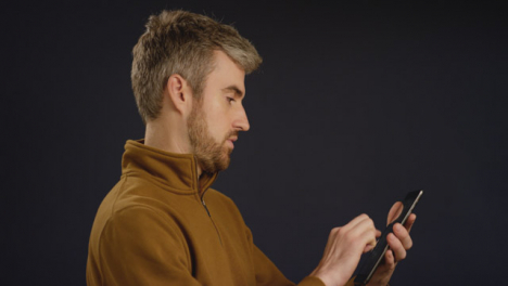 Man-Browses-on-His-Tablet