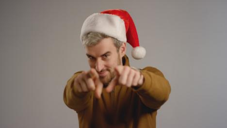 Man-Puts-on-Santa-Hat-