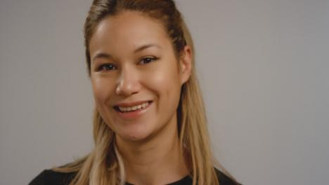 CU-Pan-of-Woman-Smiling-at-Camera
