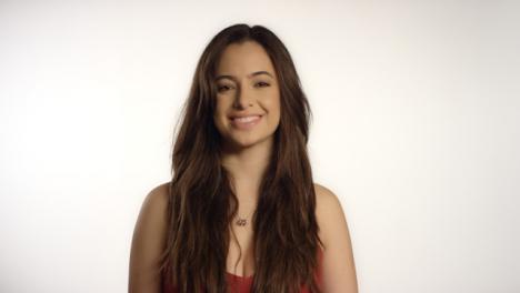 Young-Woman-Smiling-at-Camera