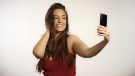 Young-Woman-Poses-for-Selfie