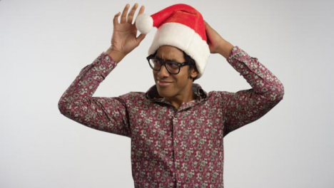 Smiling-Young-Man-Puts-on-Santa-Hat