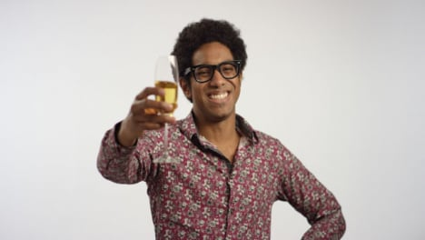 Young-Man-Smiles-Drinking-from-Glass