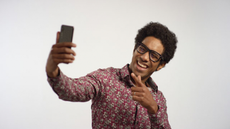 Young-Man-Take-Selfies-on-Phone