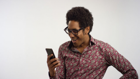 Man-Takes-Out-Phone-Scrolls-and-Smiles