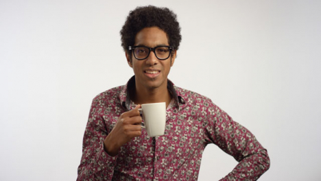 Young-Man-Drinks-Coffee-From-a-Mug