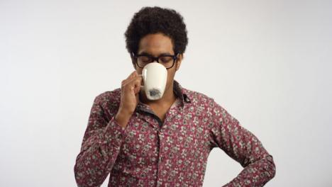 Young-Man-Drinks-Tea-From-a-Mug