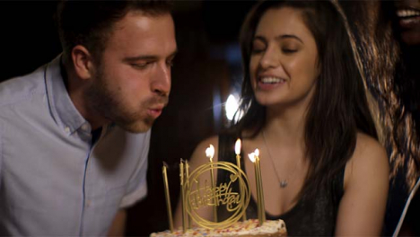 Young-Man-Blows-Out-Birthday-Cake-Candles02