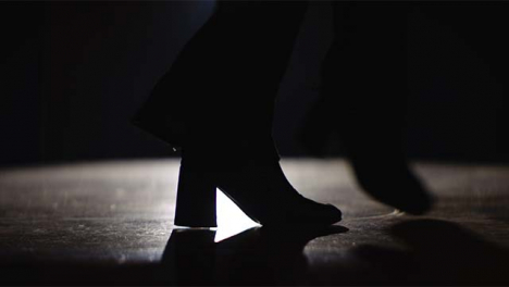 Young-Woman-s-Feet-Dancing-in-Spotlight
