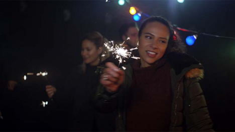 Young-Woman-Dances-With-Sparkler