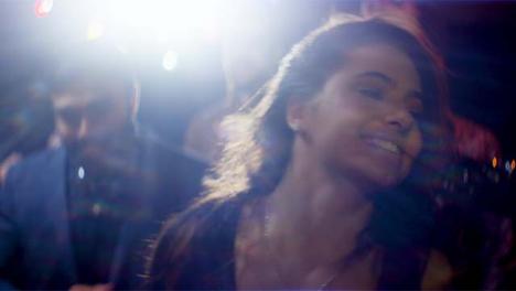 CU-Smiling-Young-Woman-Dancing