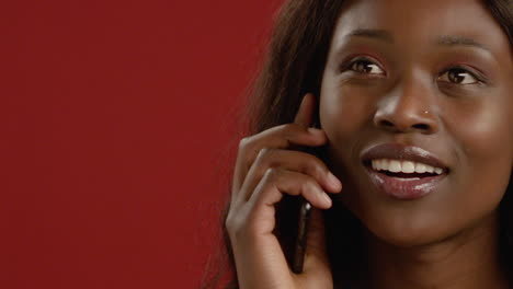 Close-Up-Young-Woman-Answers-Phone