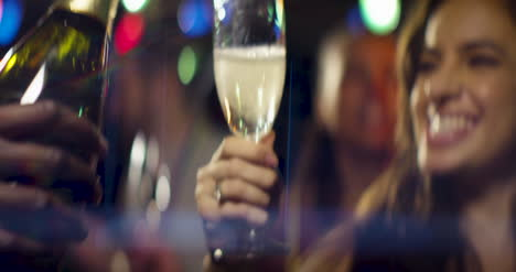 Pouring-champagne-with-happy-woman