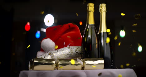 Champagne-Christmas-Hat-and-Confetti-on-Table