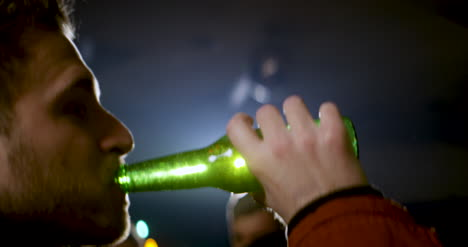 CU-Young-Man-Drinking-Beer-Bottle-