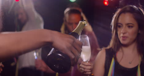 Champagne-poured-into-Young-Woman-s-Glass