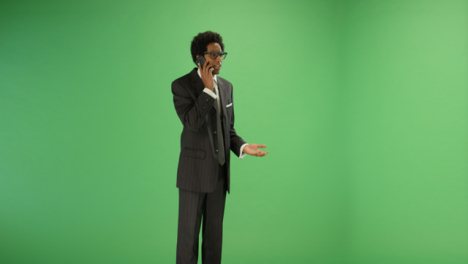 Annoyed-Businessman-talking-on-phone-with-green-screen