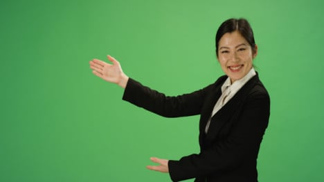 Businesswoman-gesturing-with-arms-on-green-screen