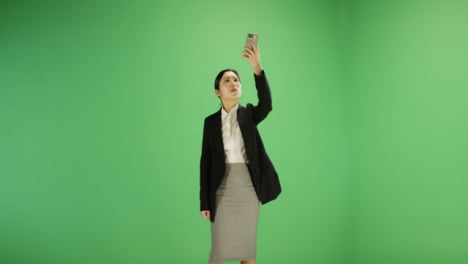 Woman-finding-phone-signal-on-green-screen
