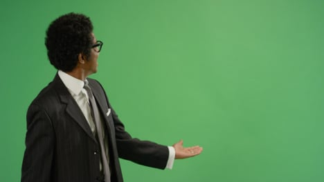 Businessman-gesturing-with-arms-on-green-screen