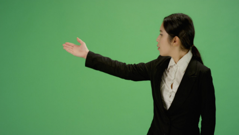 Business-woman-gesturing-with-arms-on-green-screen