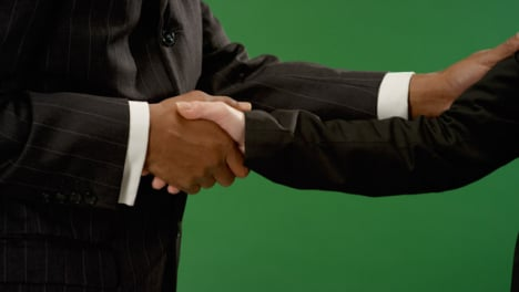CU-Man-and-woman-shaking-hands-on-green-screen