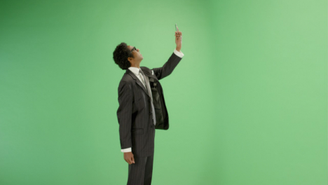 Businessman-trying-find-phone-signal-on-green-screen