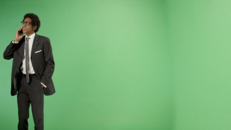 Angry-Businessman-talking-on-phone-with-green-screen