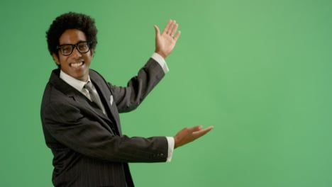 Happy-Businessman-gestures-with-arms-on-green-screen
