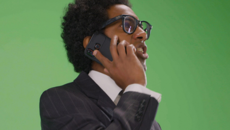 CU-Angry-Businessman-talking-on-phone-with-green-screen