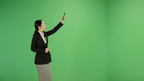 Angry-woman-trying-find-phone-signal-on-green-screen