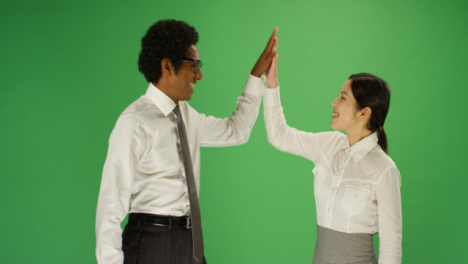 Two-people-high-5-on-green-screen